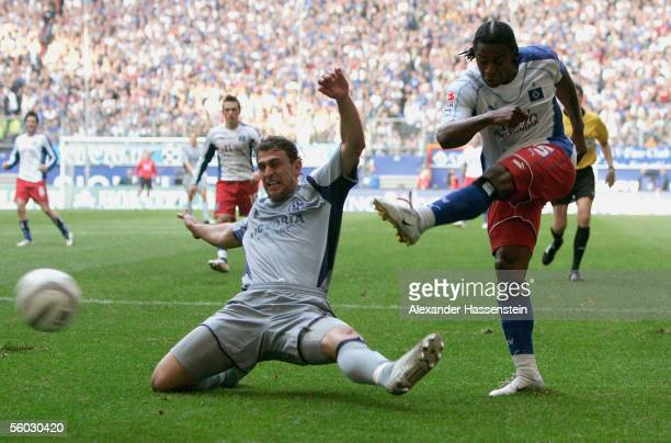 Emile Mpenza of Hamburg, in action with Marcelo Jose Bordon of Schalke during the Bundesliga match between Hamburger SV and Schalke 04 at the AOL...