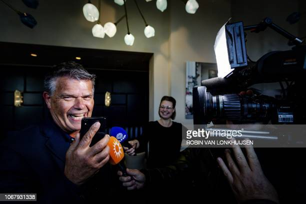 Emile Ratelband answers journalists' questions on December 3 2018 in Amsterdam following the court's ruling regarding his legal bid to slash 20 years...