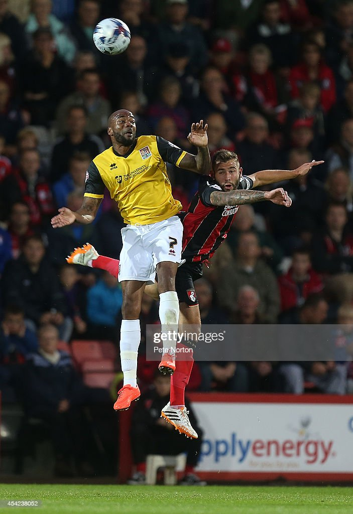 Emile Sinclair of Northampton Town challenges for the ball with Steve Cook of AFC Bournemouth during the Capital One Cup Second Round match between AFC Bournemouth and Northampton Town at Goldsands Stadium on August 26, 2014 in Bournemouth, England.