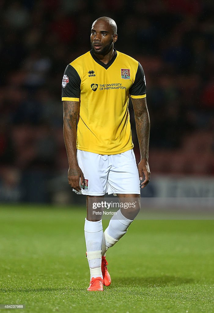 Emile Sinclair of Northampton Town in action during the Capital One Cup Second Round match between AFC Bournemouth and Northampton Town at Goldsands Stadium on August 26, 2014 in Bournemouth, England.