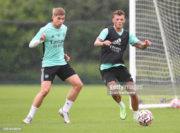 Emile Smith Rowe and Ben White of Arsenal during a training session at London Colney on July 30, 2021 in St Albans, England.