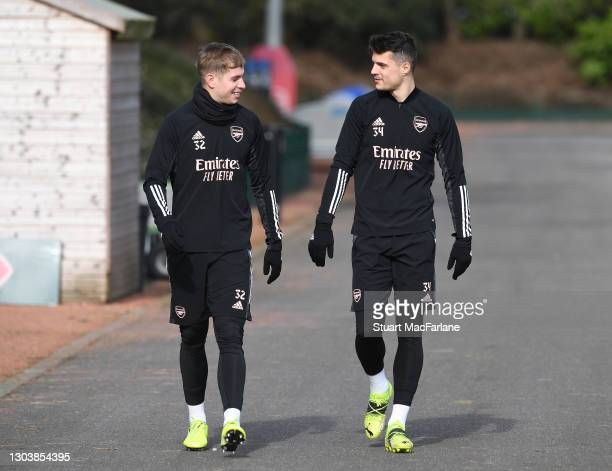 Emile Smith Rowe and Granit Xhaka of Arsenal during a trining session at London Colney on February 24, 2021 in St Albans, England.