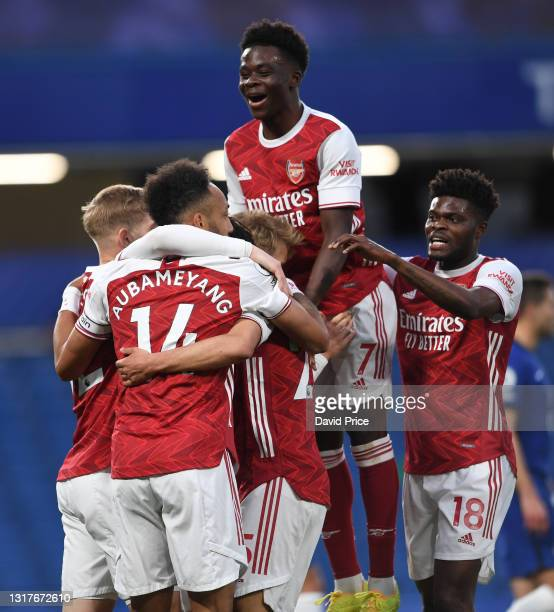 Emile Smith Rowe celebrates scoring a goal for Arsenal with Pierre-Emerick Aubameyang, Bukayo Saka and Thomas Partey during the Premier League match...