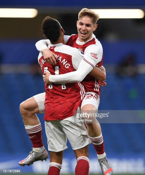 Emile Smith Rowe celebrates scoring a goal for Arsenal with Pierre-Emerick Aubameyang during the Premier League match between Chelsea and Arsenal at...
