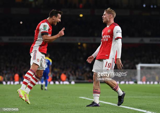 Emile Smith Rowe celebrates scoring Arsenal's 2nd goal with Cedric Soares during the Carabao Cup Third Round match between Arsenal and AFC Wimbledon...