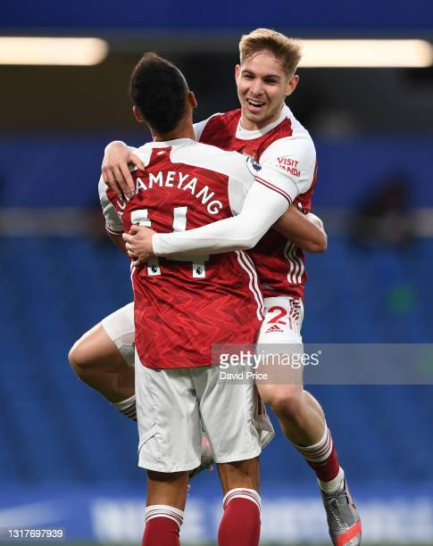 Emile Smith Rowe celebrates scoring Arsenal's goal with Pierre-Emerick Aubameyang during the Premier League match between Chelsea and Arsenal at...