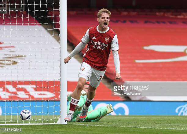 Emile Smith Rowe celebrates scoring for Arsenal during the Premier League match between Arsenal and West Bromwich Albion at Emirates Stadium on May...