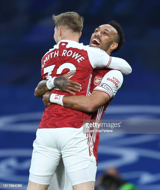 Emile Smith Rowe celebrates scoring the Arsenal goal with Pierre-Emerick Aubameyang during the Premier League match between Chelsea and Arsenal at...