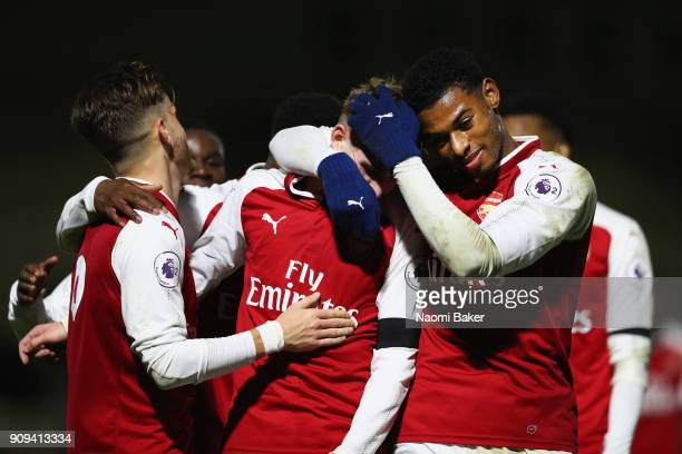 Emile Smith Rowe celebrates with Jeff ReineAdelaide after scoring his sides 5th goal during the Premier League International Cup match between...