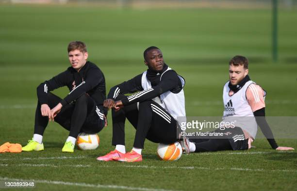 Emile Smith Rowe, Nicolas Pepe and Calum Chambers of Arsenal during a training session at London Colney on February 24, 2021 in St Albans, England.