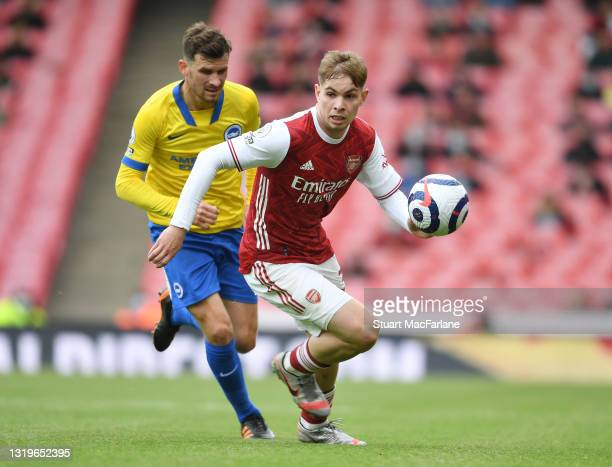 Emile Smith Rowe of Arsenal breaks past Adam Webster of Brighton during the Premier League match between Arsenal and Brighton & Hove Albion at...