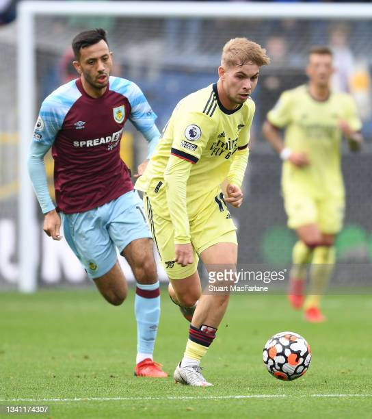 Emile Smith Rowe of Arsenal breaks past Ashley Westwood of Burnley during the Premier League match between Burnley and Arsenal at Turf Moor on...