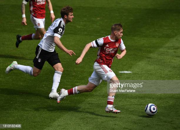 Emile Smith Rowe of Arsenal breaks past Joachim Andersen of Fulham during the Premier League match between Arsenal and Fulham at Emirates Stadium on...