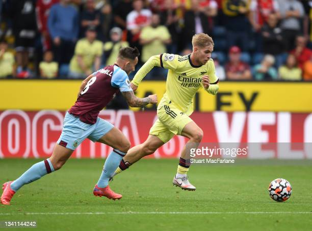 Emile Smith Rowe of Arsenal breaks past Josh Brownhill of Burnley during the Premier League match between Burnley and Arsenal at Turf Moor on...
