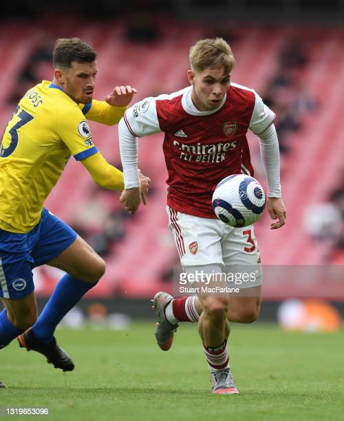 Emile Smith Rowe of Arsenal breaks past Pascal Grob of Brighton during the Premier League match between Arsenal and Brighton & Hove Albion at...