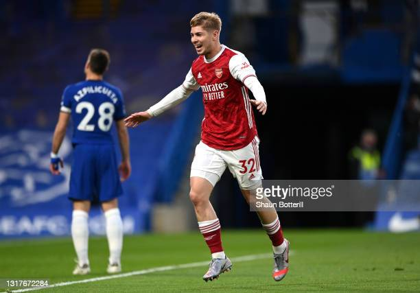 Emile Smith Rowe of Arsenal celebrates after scoring their sides first goal during the Premier League match between Chelsea and Arsenal at Stamford...