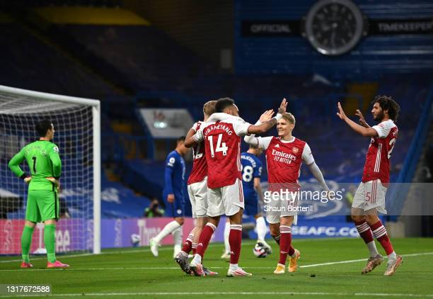 Emile Smith Rowe of Arsenal celebrates after scoring their sides first goal with team mate Pierre-Emerick Aubameyang during the Premier League match...