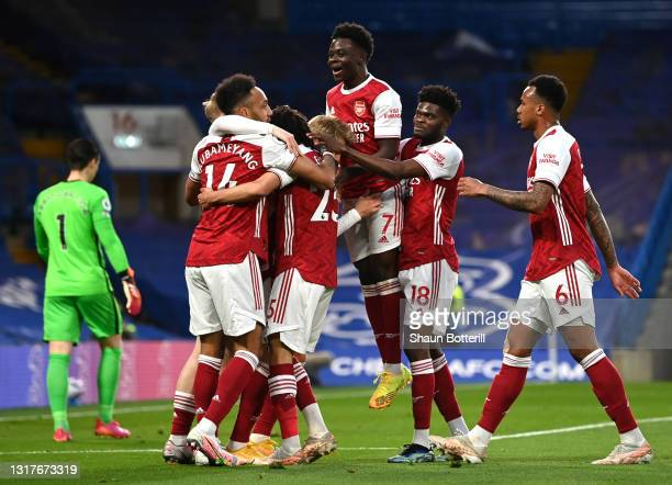 Emile Smith Rowe of Arsenal celebrates after scoring their sides first goal with team mate Pierre-Emerick Aubameyang, Mohamed Elneny and Bukayo Saka...