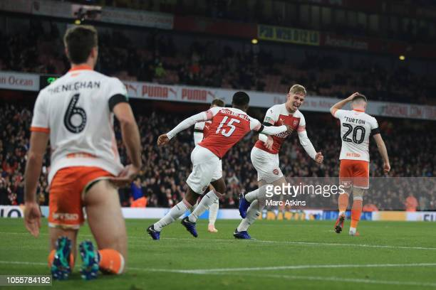Emile Smith Rowe of Arsenal celebrates scoring their 2nd goal with Ainsley MaitlandNiles during the Carabao Cup Fourth Round match between Arsenal...