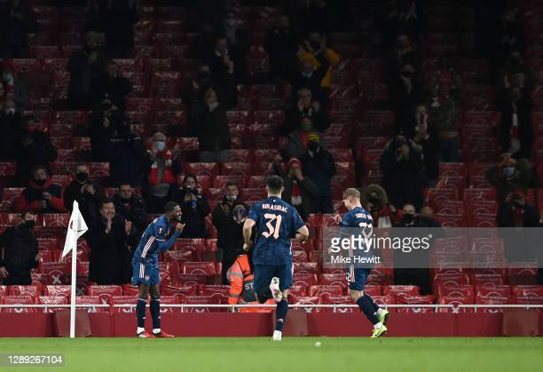 Emile Smith Rowe of Arsenal celebrates with Ainsley Maitland-Niles after scoring their team's fourth goal during the UEFA Europa League Group B stage...