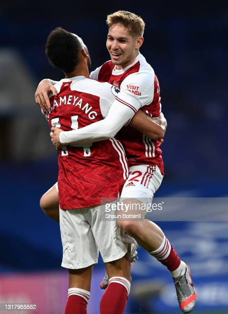 Emile Smith Rowe of Arsenal celebrates with Pierre-Emerick Aubameyang after scoring their side's first goal during the Premier League match between...