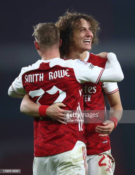 Emile Smith Rowe of Arsenal celebrates with teammate David Luiz after scoring their sides first goal during the FA Cup Third Round match between...