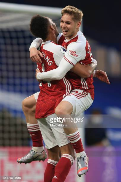 Emile Smith Rowe of Arsenal celebrates with teammate Pierre-Emerick Aubameyang after scoring his team's first goal during the Premier League match...