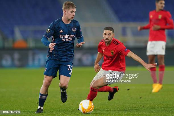 Emile Smith Rowe of Arsenal compete for the ball with Adel Taarabt of SL Benfica during the UEFA Europa League Round of 32 match between SL Benfica...