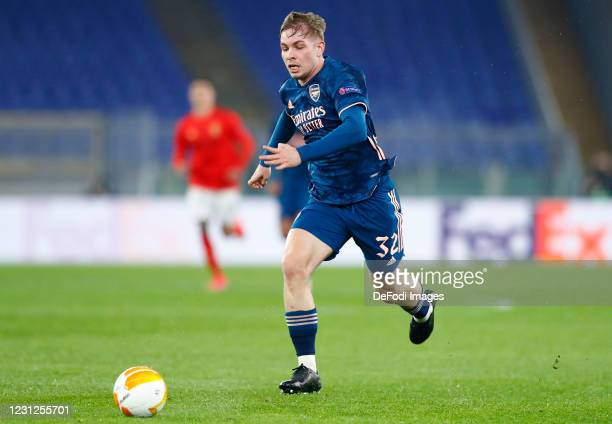 Emile Smith Rowe of Arsenal FC controls the ball during the UEFA Europa League Round of 32 match between SL Benfica and Arsenal FC at Stadio Olimpico...