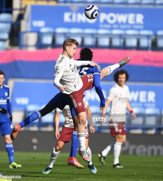 Emile Smith Rowe of Arsenal jumps with Wilfred Ndidi of Leicester during the Premier League match between Leicester City and Arsenal at The King...