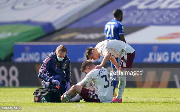 Emile Smith Rowe of Arsenal receives medical attention during the Premier League match between Leicester City and Arsenal at The King Power Stadium...