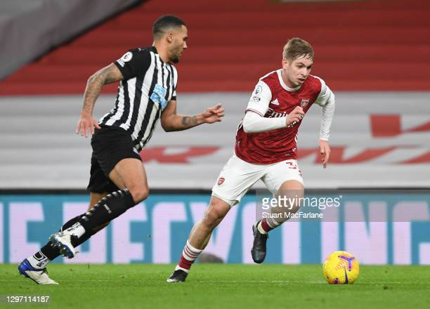 Emile Smith Rowe of Arsenal takes on Jamaal Lascelles of Newcastle during the Premier League match between Arsenal and Newcastle United at Emirates...