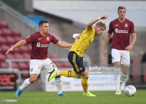 Emile Smith Rowe of Arsenal takes on Matty Warburton of Northampton during the Leasingcom match between Northampton Town and Arsenal U21 at PTS...