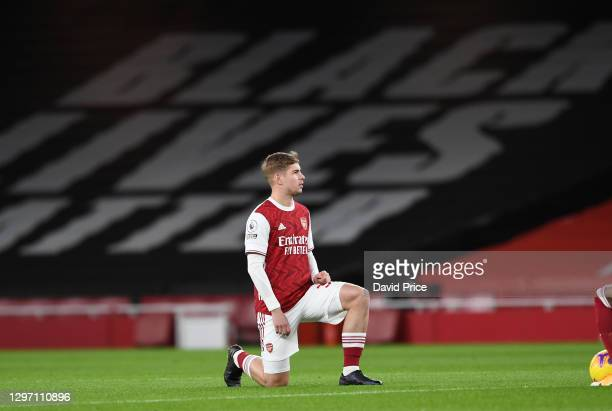 Emile Smith Rowe of Arsenal takes the knee during the Premier League match between Arsenal and Newcastle United at Emirates Stadium on January 18,...