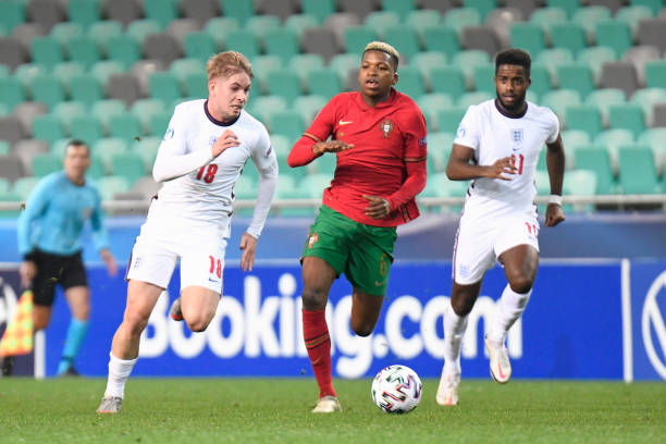 Emile Smith Rowe of England runs with the ball whilst under pressure from Florentino of Portugal during the 2021 UEFA European Under-21 Championship...