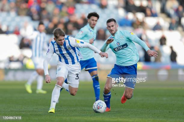 Emile Smith Rowe of Huddersfield Town and Dominic Ball of Queens Park Rangers during the Sky Bet Championship match between Huddersfield Town and...