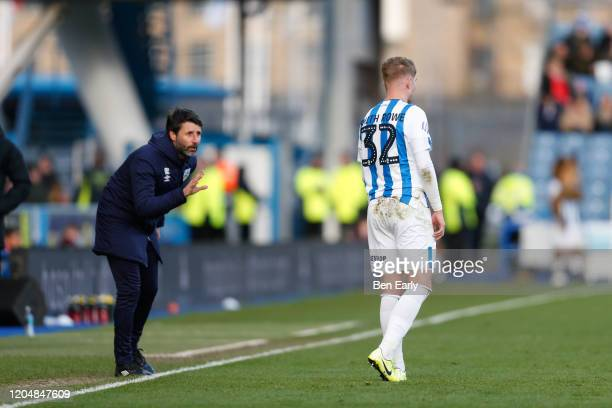 Emile Smith Rowe of Huddersfield Town receives instructions from Danny Cowley the Manager / Head Coach of Huddersfield Town during the Sky Bet...