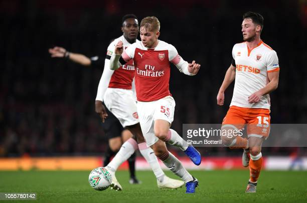 Emile Smith-Rowe of Arsenal is challenged by Jordan Thompson of Blackpool during the Carabao Cup Fourth Round match between Arsenal and Blackpool at...