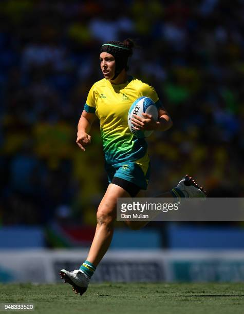 Emilee Cherry of Australia breaks through to score a try during the Rugby Sevens Women's SemiFinal between Australia and Canada on day 11 of the Gold...