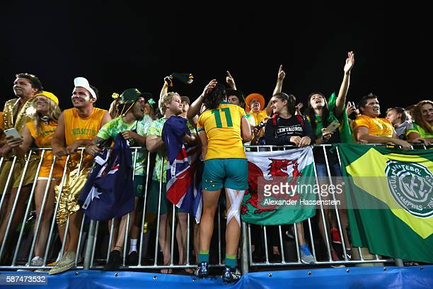 Emilee Cherry of Australia celebrate victory after winning the Women's Gold Medal Final Rugby Sevens match between Australia and New Zealand on...