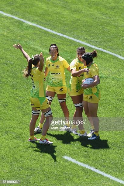 Emilee Cherry of Australia celebrates scoring a try with team mates during the HSBC World Rugby Women's Sevens Series 2016/17 Kitakyushu quarter...