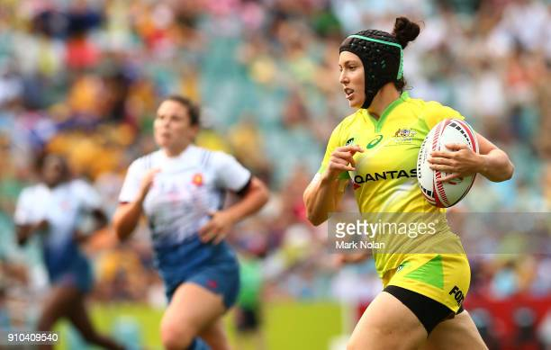 Emilee Cherry of Australia heads for the try line in the womens pool match between Australia and France during day one of the 2018 Sydney Sevens at...
