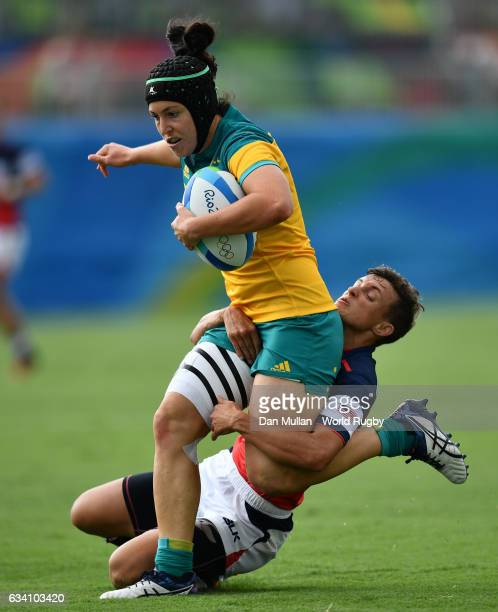 Emilee Cherry of Australia is tackled by Jessica Javelet of the United States during the Women's Rugby Sevens Pool A match between Australia and the...