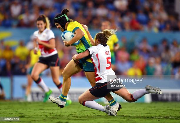 Emilee Cherry of Australia is tackled by Natasha Hunt of England during the Rugby Sevens Women's Pool B match between Australia and England on day...