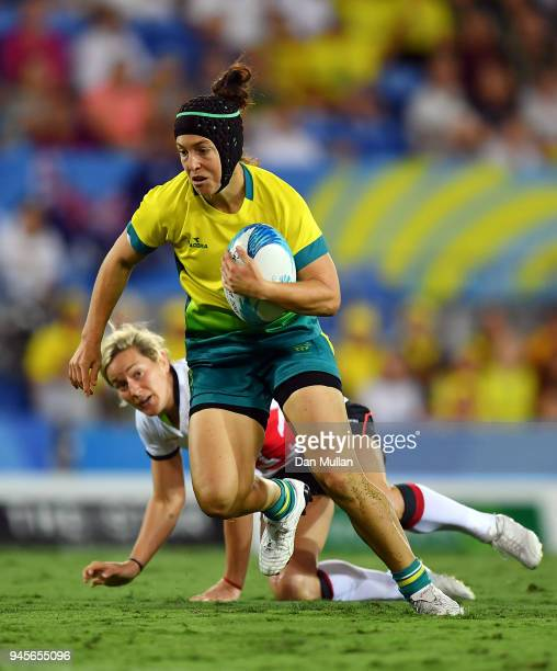 Emilee Cherry of Australia makes a break during the Rugby Sevens Women's Pool B match between Australia and England on day nine of the Gold Coast...