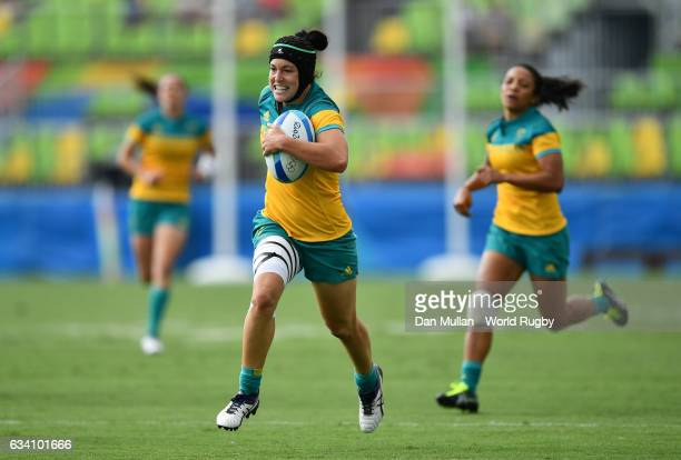 Emilee Cherry of Australia makes a break during the Women's Rugby Sevens Pool A match between Australia and the United States on Day 2 of the 2016...