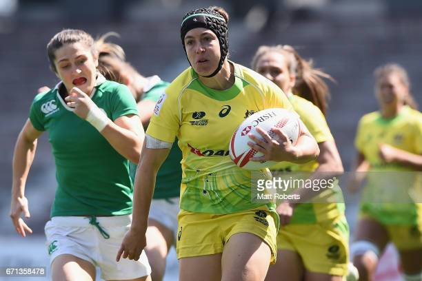 Emilee Cherry of Australia makes a break to score a try during the HSBC World Rugby Women's Sevens Series 2016/17 Kitakyushu pool match between...