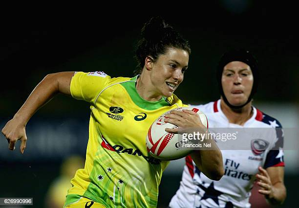 Emilee Cherry of Australia runs with the ball during day one of the Emirates Dubai Rugby Sevens HSBC World Rugby Women's Sevens Series on December 1...