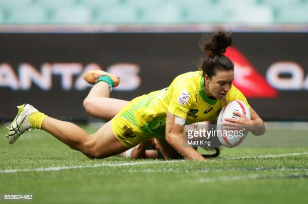 Emilee Cherry of Australia scores a try during the womens pool match between Australia and Ireland in the 2017 HSBC Sydney Sevens at Allianz Stadium...