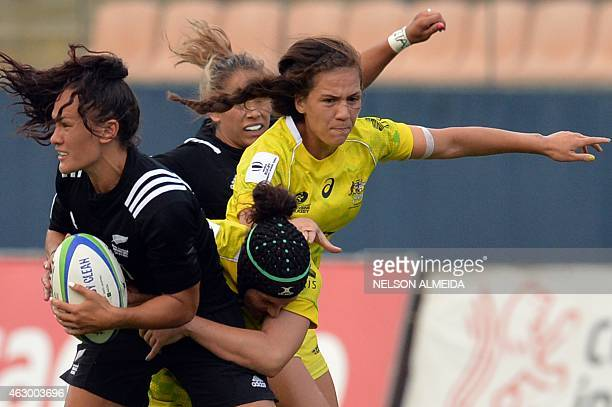 Emilee Cherry of Australia tackles Portia Woodman of New Zealand during the IRB Women's Sevens World Series final match in Barueri, some 30 km from...